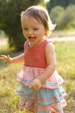 One-year-old girl on walk in park Royalty Free Stock Image