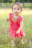 One-year-old girl on walk in park Stock Photo