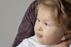 One year old happy disabled child portrait close-up - image stock image