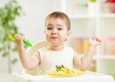 One year old kid boy in a highchair for feeding Stock Photography