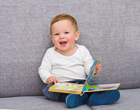 The one-year-old kid sits Stock Photography