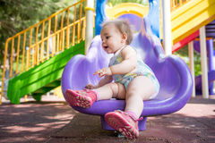 One Year Old Little Baby Girl Playing At Playground Outdoors In Royalty Free Stock Image