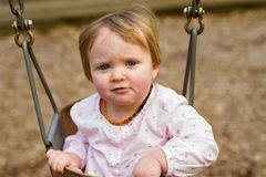 One Year Old on Swings Royalty Free Stock Photo