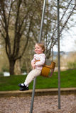 One Year Old on Swings Stock Photography