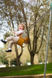 One Year Old on Swings Royalty Free Stock Image