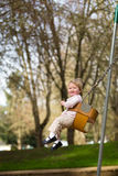 One Year Old on Swings Stock Photo