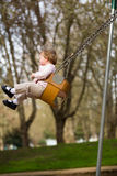 One Year Old on Swings Royalty Free Stock Photography