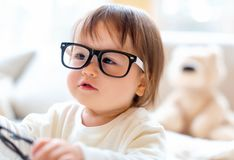 One year old toddler boy with eyeglasses royalty free stock photography
