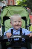 One years boy with baby carriage Stock Photo
