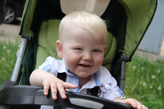 One years boy with baby carriage Stock Images