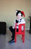 One funny child clothed in a fancy-dress of a tomcat in a room Royalty Free Stock Photography