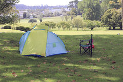 One yellow and blue tent in a park Royalty Free Stock Photos