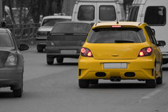 One yellow car in traffic jam Stock Images