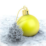 One yellow christmas ball and a small tree on a snowy ground. One yellow huge christmas ball and a small tree on a snowy ground Stock Image