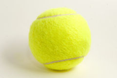One yellow felt tennis ball. On white background Royalty Free Stock Photography