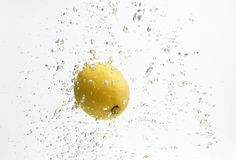 One Yellow Lemon And Water. Royalty Free Stock Images