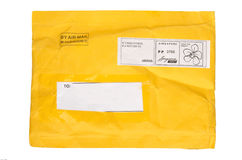 One yellow mail package from recycling paper Stock Photo