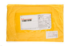 One yellow mail package from recycling paper Royalty Free Stock Image