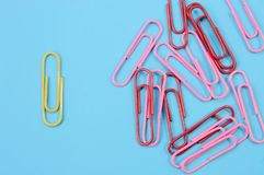 Paper clips on blue. Top view. royalty free stock image