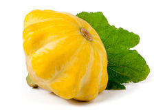 One yellow pattypan squash with leaf isolated on white background Royalty Free Stock Photos