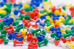 One yellow pin in many colors pin,different Concept and Selectiv Stock Photos