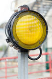 One yellow signal street light Royalty Free Stock Photos