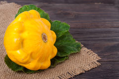 One yellow squash on a wooden background with napkin of burlap Royalty Free Stock Photography