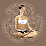 One yoga woman practicing  lotus pose.Paisley back Royalty Free Stock Photography