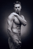 One young adult man, Caucasian, fitness model, muscular body, sh Royalty Free Stock Photography