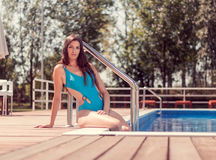 One young adult woman Caucasian model posing, long hair, sitting Stock Photo