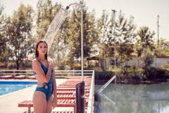 One young adult woman model smiling enjoying, standing, water sh Stock Photography