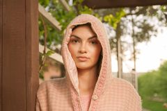 One young adult woman, wearing hood ethno clothes Serbian, East Royalty Free Stock Photo