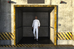 One young black man in a white suit, steps out of the Elevator Stock Photography
