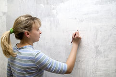 One young blonde with pencil Royalty Free Stock Photography