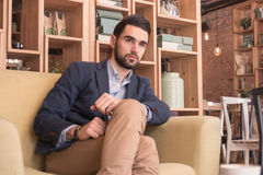 One young handsome man sitting sofa coffee bar indoors interior stock images