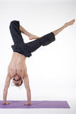 One young healthy sporty caucasian man exercising yoga on isolated white studio background. Stock Image