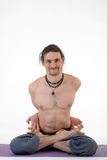 One young healthy sporty caucasian man exercising yoga on isolated white studio background. Royalty Free Stock Photo