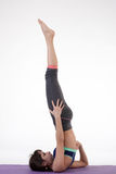 One young healthy sporty caucasian woman exercising yoga on isolated white studio background. Royalty Free Stock Photo