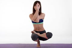 One young healthy sporty caucasian woman exercising yoga on isolated white studio background. Stock Images