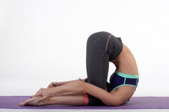 One young healthy sporty caucasian woman exercising yoga on isolated white studio background. Stock Photography