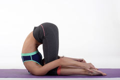 One young healthy sporty caucasian woman exercising yoga on isolated white studio background. Royalty Free Stock Images