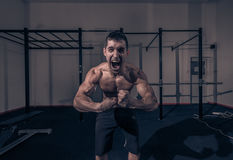 One young man, bodybuilder screaming shouting face head closeup Royalty Free Stock Photo