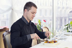 One young man dines Stock Images