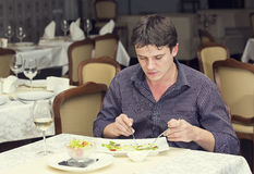 One young man dines Royalty Free Stock Images