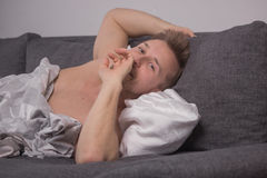 One young man head closeup, bed pillow Royalty Free Stock Image