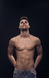 One young man looking above up, shirtless body fit abs Stock Photography