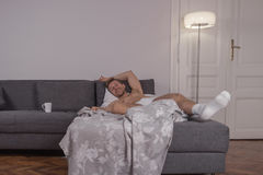 One young man, lying laying bed sheet, happy smiling Royalty Free Stock Photos