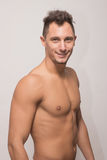 One young man model smile smirk, upper body, side view. One adult young man model smile smirk, upper body, side view, shirtless muscular, polaroid snapshot royalty free stock photography