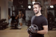 One young man, ordinary average looking, one arm dumbell exercise, royalty free stock photos