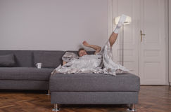 One young man playful falling bed sheets Royalty Free Stock Photography